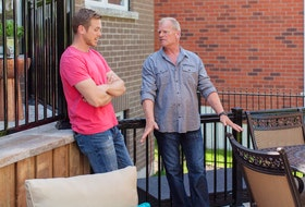 Inspect your deck yearly. Mike Jr. and Mike Holmes on a homeowners new deck during a reveal day.