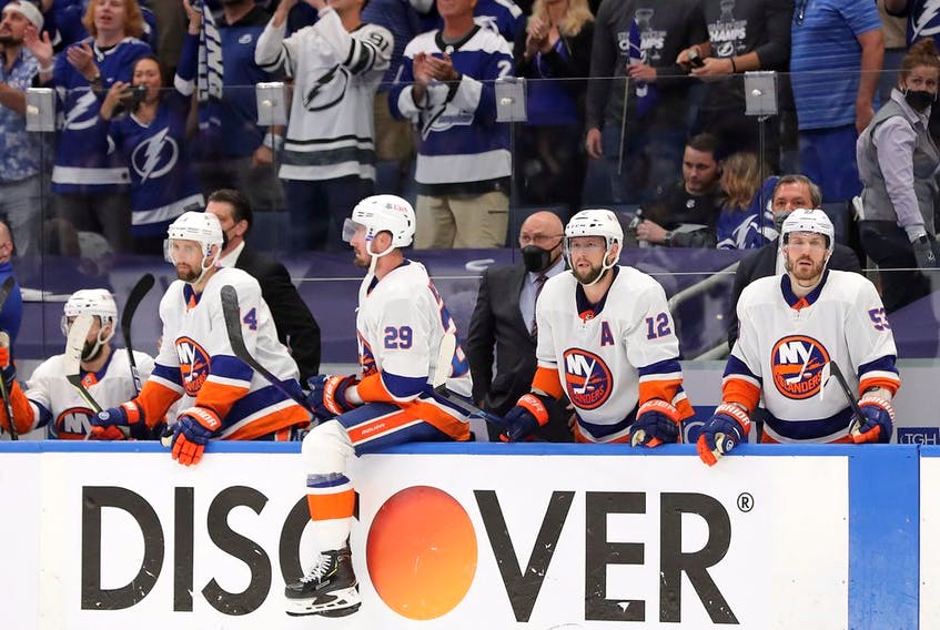 The New York Islanders react to their 8-0 loss to the Tampa Bay Lightning in Game 5 of the Stanley Cup semifinals at Amalie Arena on June 21, 2021 in Tampa.