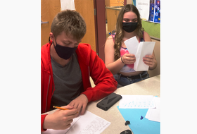Colby Cunningham and Sarah Penney are among students in the health and human services class at Dr. J.H. Gillis to write letters to residents at the R.K. MacDonald Nursing Home in Antigonish.