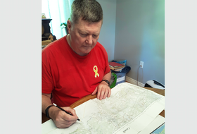 Kevin Byrne looks over a map of the route he will be following beginning Thursday to commemorate the 80th anniversary of the march by the North Nova Scotia Highlanders from the Col. James Layton Ralston Armoury in Amherst to their assembly area in Debert in May 1941