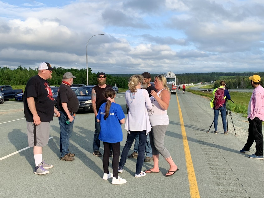 Protesters stand in the middle of the westbound lane of Highway 104 early Tuesday evening. - Darrell Cole