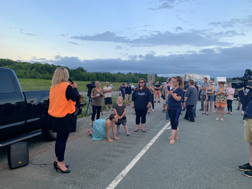 Cumberland North MLA Elizabeth Smith-McCrossin talks to protesters blocking Highway 104 at Exit 7 near Thomson Station, N.S. on Tuesday. - Darrell Cole
