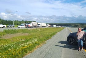 Vehicles block the westbound lane of the Trans-Canada Highway at Thomson Station near Oxford, N.S. on Tuesday afternoon. The blockage was in protest to Nova Scotia's decision not to fully reopen the border with New Brunswick. Michael MacDonald photo