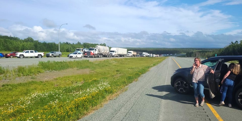 Vehicles block the westbound lane of the Trans-Canada Highway at Thomson Station near Oxford, N.S. on Tuesday afternoon. The blockage was in protest to Nova Scotia's decision not to fully reopen the border with New Brunswick. Michael MacDonald photo - Contributed