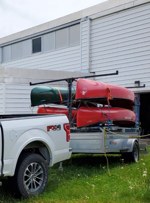 Police say thieves stole these four canoes, the utility trailer and some paddling equipment from the Lawrencetown Education Centre property in Annapolis County sometime between June 19 and June 20. – Contributed