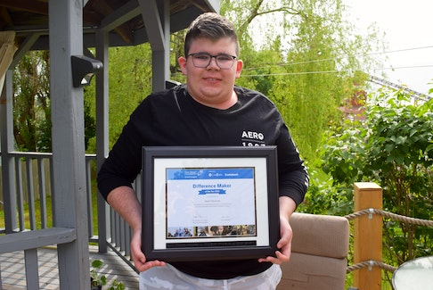 Noah Eldershaw pictured with his Difference Maker of the Year Award from the Rick Hansen Foundation School Program. Noah always makes sure people feel included.