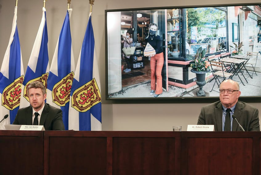 Nova Scotia Premier Iain Rankin and Dr. Robert Strang, the province's chief medical officer of health, give a COVID-19 briefing Thursday, June 17, 2021.