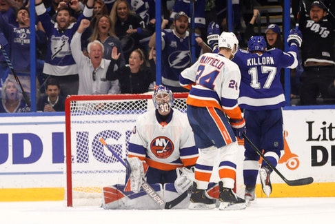Tampa Bay Lightning left wing Alex Killorn celebrates as he scores a goal on New York Islanders goaltender Ilya Sorokin during the second period in Game 5  of the Stanley Cup semifinals at Amalie Arena in Tampa, Fla., June 21, 2021.