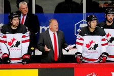 Summerside native and Team Canada head coach Gerard (Turk) Gallant, front, second left, questions a call during a quarter-final game against Russia at the 2021 International Ice Hockey Federation (IIHF) world championship in Latvia recently. Assistant coach Mike Kelly, back left, of Charlottetown looks on.  The New York Rangers introduced Gallant as the team's 36th head coach during a media conference over Zoom on June 22.