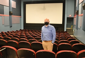 Cineplex Sydney general manager Kevin MacDonald stands in one of the complex's 10 auditoriums on Tuesday. MacDonald and other Cineplex managers across Nova Scotia will resume movie showings on Wednesday after the latest shutdown that lasted almost two months. DAVID JALA/CAPE BRETON POST
