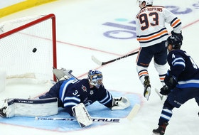 Edmonton Oilers centre Ryan Nugent-Hopkins beats Winnipeg Jets goaltender Connor Hellebuyck during Game 4 of a Stanley Cup playoff series in Winnipeg on Mon., May 24, 2021.