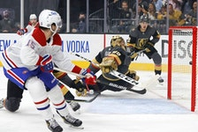 Jesperi Kotkaniemi of the Montreal Canadiens scores a goal past Marc-André Fleury of the Vegas Golden Knights during the first period of Game 5 at T-Mobile Arena in Las Vegas on June 22, 2021.
