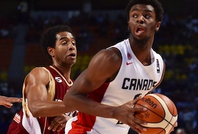 Venezuela's point guard Gregory Vargas (L) and teammate John Cox (C) mark Canada's shooting guard Andrew Wiggins (R) during their 2015 FIBA Americas Championship Men's Olympic Semi-final match at the Sport Palace in Mexico City on September 11, 2015.