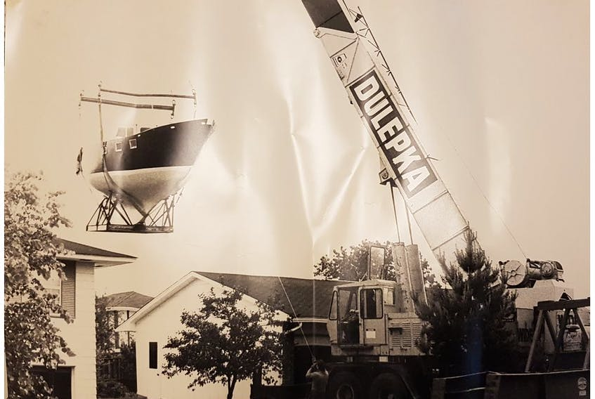 Anderson'sbuilt-in-the-backyard yachtbeing lifted over the house to be launched at Hartwell's locks in Ottawa(circa 1982).