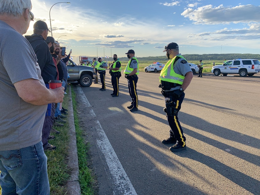 RCMP line the eastbound lane of the Trans-Canada Highway at Fort Lawrence, N.S., breaking up a blockade that stopped the flow of traffic across the Nova Scotia-New Brunswick border for nearly 24 hours. - Darrell Cole