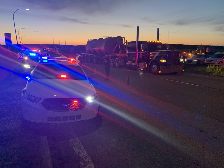A long line of traffic, most transport trucks, moved across the border just before 10 p.m. on Wednesday night. RCMP ended a blockade lasting nearly 24 hours. - Darrell Cole