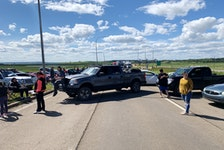 Traffic was blocked on the Trans-Canada Highway at the New Brunswick-Nova Scotia border in Fort Lawrence, N.S. on Tuesday. Protesters moved their blockade of Highway 104 from Thomson Station to the border on Tuesday night.