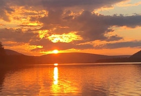 """This lovely photo is for all of you with family connections to beautiful Cape Breton Island.  The tangerine sky photo was taken by Lisa Murray, coincidentally enough in Orangedale East on the shores of the Bras D'Or Lakes.  This showstopper of a sunset filled the sky last Sunday - Father's Day!    Lisa says: """"It is my favourite spot as I spent many a day there years ago while my dad was working around his oysters (he passed in 2005).  I had a feeling the sunset wouldn't disappoint, and it didn't!"""""""