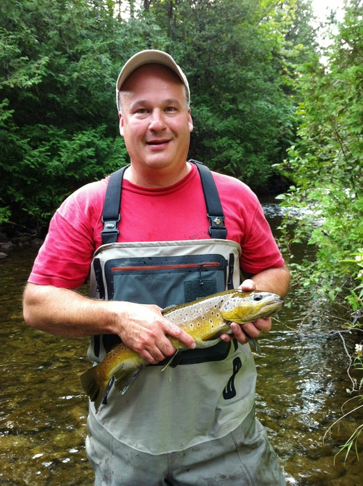 Dr. Ken Oakes, associate professor at Cape Breton University, seen here holding a fish at the Hockley Valley Provincial Nature Reserve in Ontario. CONTRIBUTED - Jessica Smith