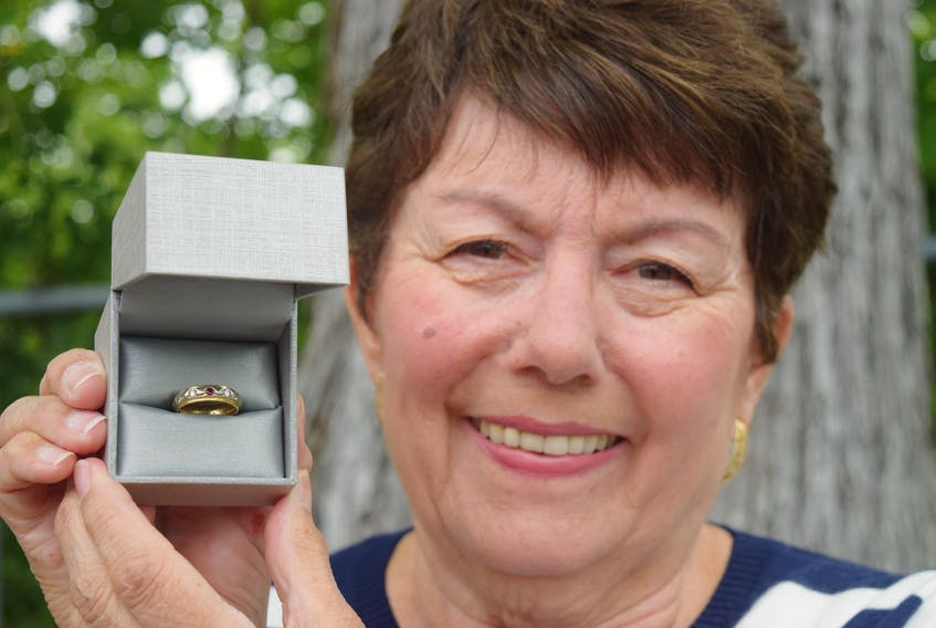 Sharon King of Ben Eoin holds a ruby and diamond ring her friend, the late Linda Mercer, found 20 years ago in Sydney River. King hopes to find the owner and possibly, the love story behind the ring.  Sharon Montgomery-Dupe/Cape Breton Post
