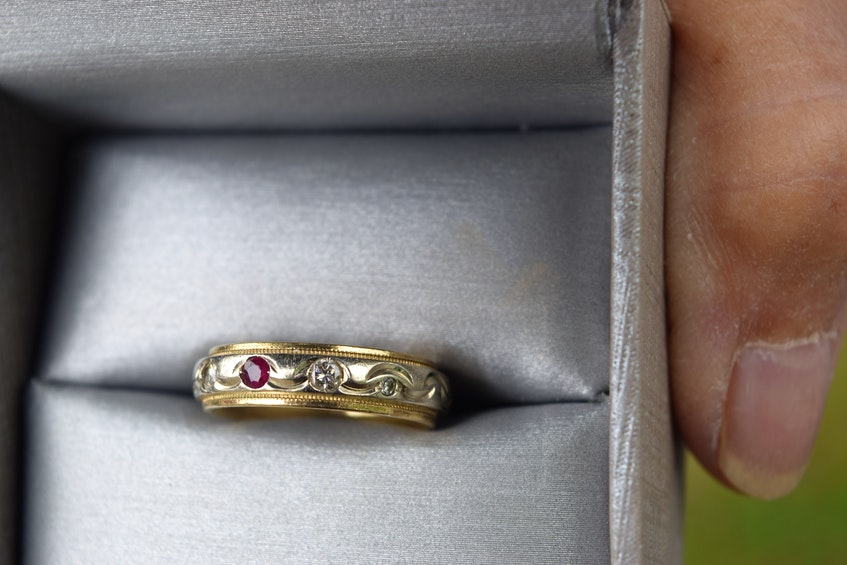 This is the ruby and diamond ring found by the late Linda Mercer in Sydney River 20 years ago. The ring has two sets of initials inscribed on it. Mercer's friend Sharon King hopes to reunite it with its original owner.  Sharon Montgomery-Dupe/Cape Breton Post - Sharon Montgomery