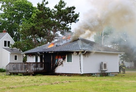 Firefighters battled a blaze in this residential housing unit at 14 Wing Greenwood on June 19. – Adrian Johnstone