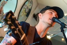 Nick Earle, winner of the MusicNL Rock Artist of the Year Award, performs at the Loose Tie Wednesday afternoon during an event held by the George Street Association.   Keith Gosse/The Telegram
