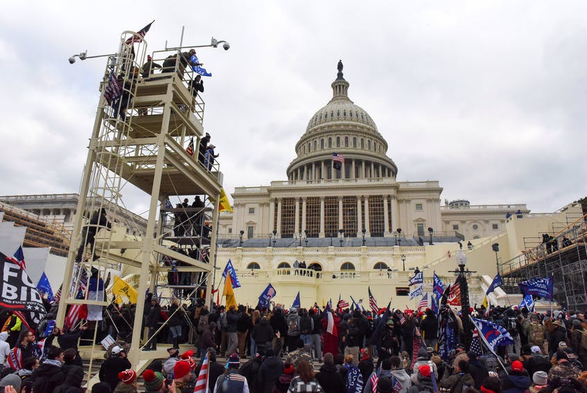Supporters of U.S. President Donald Trump gather in front of the U.S. Capitol Building in Washington, D.C., in January. REUTERS/Stephanie Keith