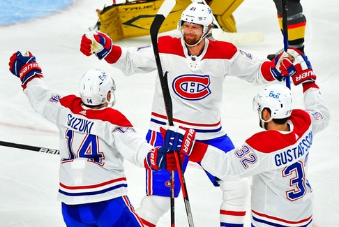 Montreal Canadiens' Eric Staal celebrates with Nick Suzuki and Erik Gustafsson after scoring a second-period goal against the Vegas Golden Knights in Game 5 at T-Mobile Arena in Las Vegas on June 22, 2021.