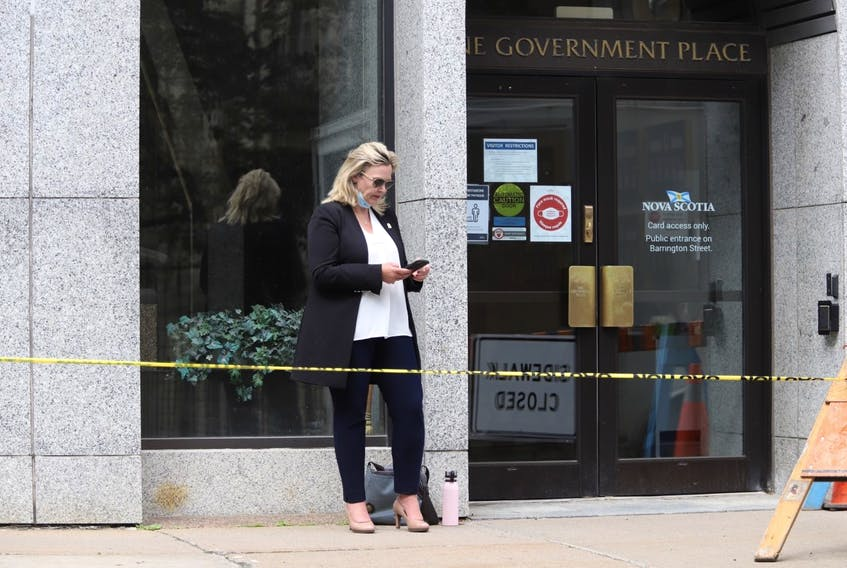 Cumberland North PC MLA Elizabeth Smith-McCrossin stands outside One Government Place in downtown Halifax on Wednesday morning, June 23, 2021, hoping to meet with Nova Scotia Premier Iain Rankin to convince him to lift travel restrictions between the province and New Brunswick.