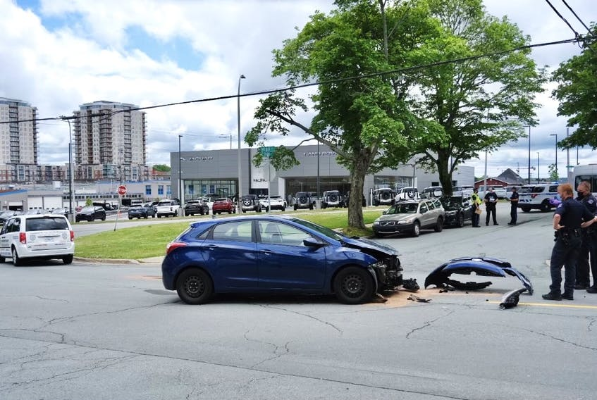 A car sits at the site of a fatal crash at the corner of Stairs and Robie streets in Halifax on Wednesday, June 23, 2021.