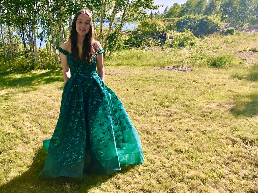 Riverview High School graduate Laura Colford stands in the backyard of her South Bar home, wearing her prom dress which she's not sure she'll get to wear due to pandemic health protection measures in Nova Scotia. NICOLE SULLIVAN/CAPE BRETON POST - Nicole Sullivan