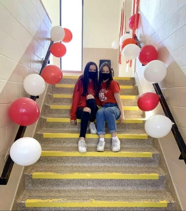 Laura Colford, right, sits with her friend Chloe Morrison on their last day of school at Riverview High School on June 11. CONTRIBUTED  - Contributed