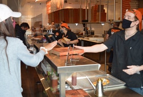 Guests at Blaze Pizza will be greeted by a number of staff, including Travis Mathers, who wil ask about menu choices and special dietary needs.
