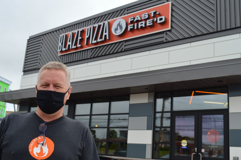 Irwin Dawson, right, helped bring the Blaze Pizza chain to Charlottetown. It opened at the corner of University Avenue and Belvdedere Avenue on June 22. - Dave Stewart