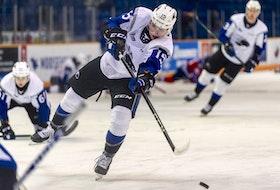 Saint John Sea Dogs left-winger Simon Hughes takes a shot during warm-up before a game in the 2020-21 Quebec Major Junior Hockey League season.