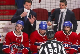 Canadiens assistant coach Luke Richardson speaks with linesman Brian Pancich while fellow assistant coach Alex Burrows looks on from behind bench during Game 3 of Stanley Cup semifinal series against the Vegas Golden Knights at the Bell Centre.