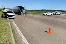 RCMP stand by the Trans-Canada Highway at the Nova Scotia border in Fort Lawrence early Thursday, a day after they broke up a blockade that stopped traffic from entering or leaving the province.