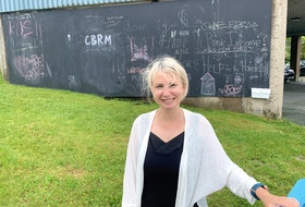 Lisa Mulak, regional librarian at the Cape Breton Regional Library, stands in front of the community chalkboard they installed on a large concrete wall at the Sydney branch. Mulak said it's a way to give the community an outlet for creative expression at a time when they can't host in-person programs. Chris Connors/Cape Breton Post