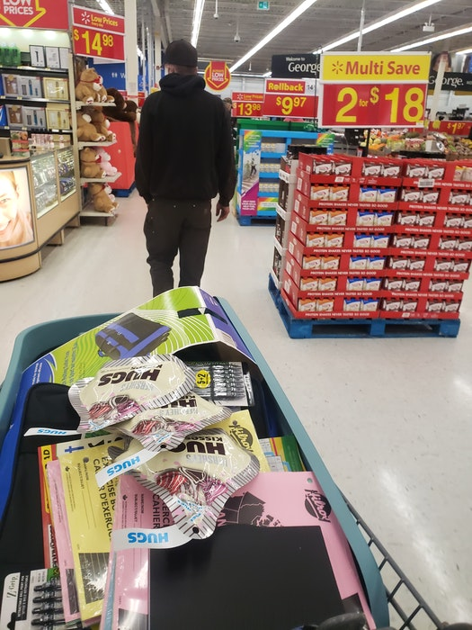 Justin Arsenault walks down a Walmart aisle, cart full behind him, as he stops to buy gifts for the residents of the Chez-Nous Co-Operative.  - Contributed