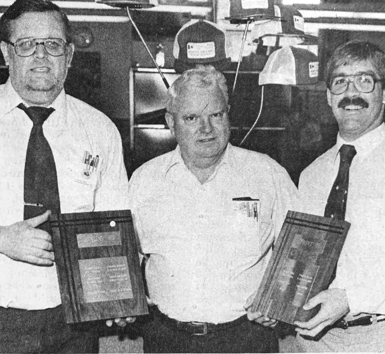 Windsor Post Office employees, from left, Jim Cross, Charles Miller and Kent Reading received plaques after the local post office recorded the highest retail product sales in December 1985 in the Atlantic Provinces. - File Photo