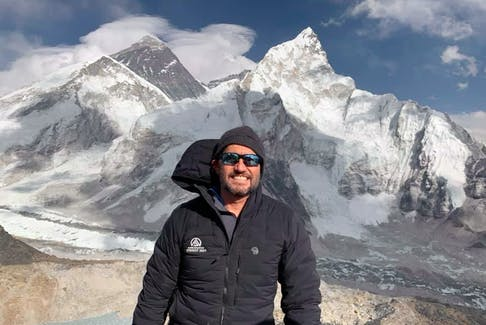 On April 14, Windsor, N.S. dentist Kevin Walsh was all smiles as he embarked on the journey of a lifetime. Pictured behind him is Mount Everest, the grey mountain on the left, and Nuptse on the right. Walsh, 55, reached the summit of Everest on May 23.