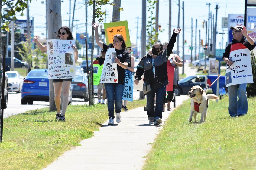 Family and friends marching in honour of Colton Cook and Zack Lefave acknowledge honks from passing motorists during a June 24 march in Yarmouth. TINA COMEAU • TRICOUNTY VANGUARD - Saltwire network