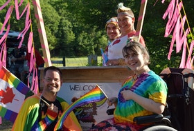 Pride Ambassador Mike Butler, a Kentville native and councillor for the Town of Wolfville pictured in the front, joins in on a photo booth session.