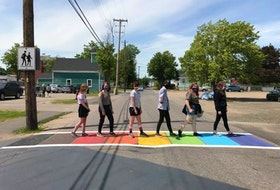 Members of the Middleton Regional High School Middle Level GSA officially open a newly painted rainbow crosswalk in town. CONTRIBUTED