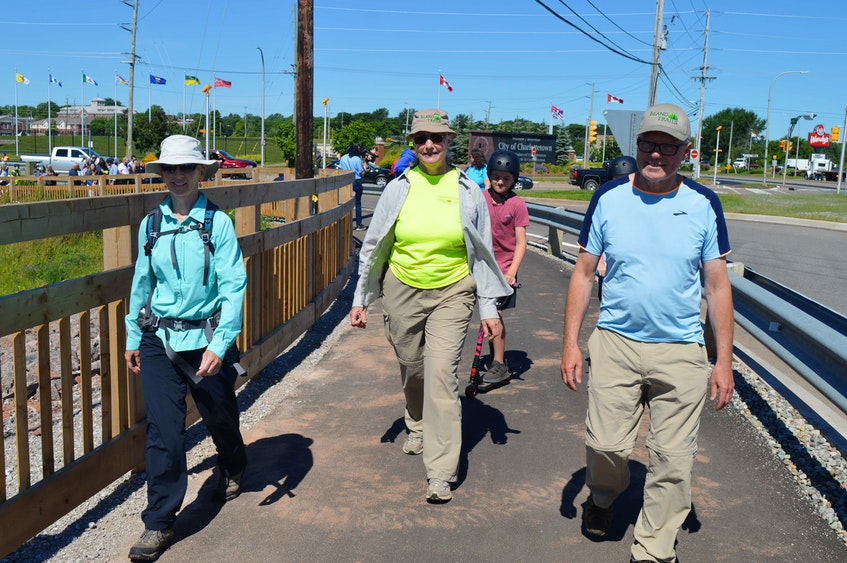 Nora Wotton, from left, Cathy Schaap and Bryson Guptill set off for a walk on Thursday, June 24 on the Hillsborough Bridge active transportation path after an official ceremony was held at the Charlottetown Event Grounds. - Dave Stewart