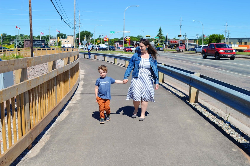 Karri Shea and her son, Linden, set out on June 24 for a walk on the Hillsborough Bridge active transportation path. - Dave Stewart • The Guardian