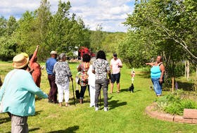 Karen Patterson provides those who took in the renaming of Martin Drive to Reddick Lane on June 17, to honour her family's legacy, with a family history tour.