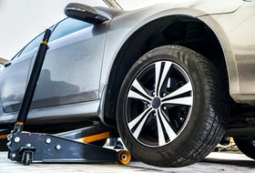 Always ensure safe and proper jack placement, lest you cause structural damage to your vehicle. 123rf stock photo