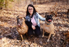 """Heidi MacLean of Wilmot recently launched a GoFundMe campaign called """"The Cost of Muscular Dystrophy"""" in hopes of raising some money that will help offset rising medical costs associated with a chronic condition that she hopes to have surgically corrected in early July. She is pictured with her dogs, Django and Justice. – Contributed"""